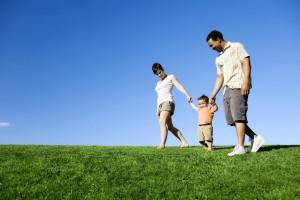 rbi family strolling in park photo